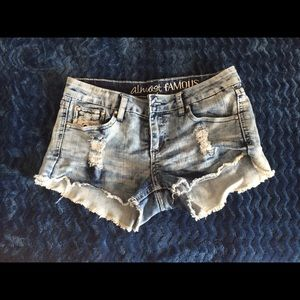 Distressed jean shorts with lace on back pockets